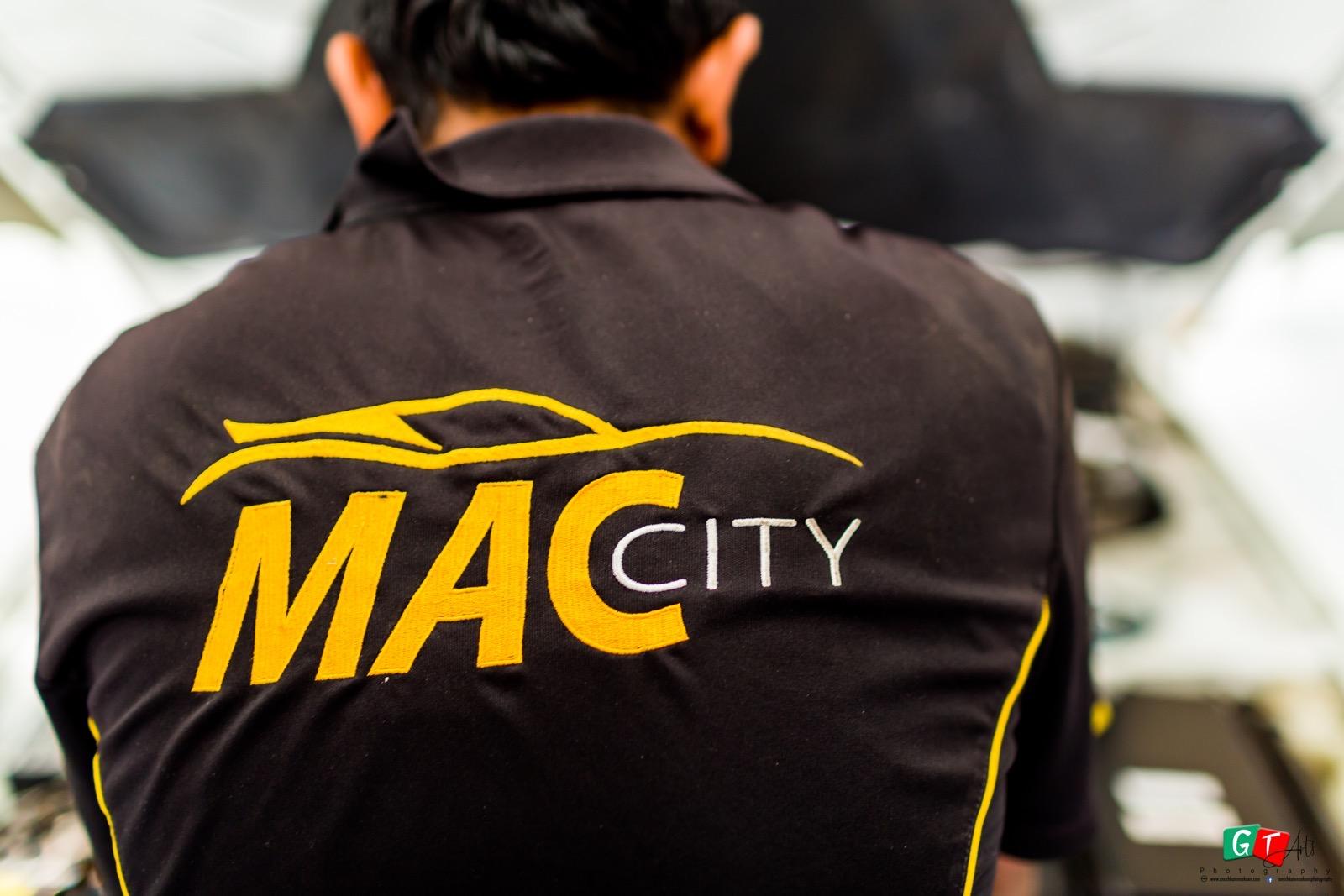 Mac City staff working on a car repair